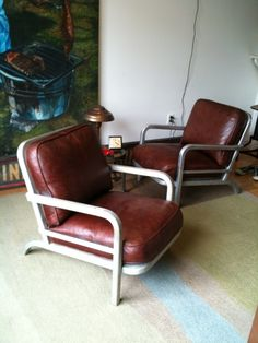 Pair of leather/ aluminum Deco Modern chairs.