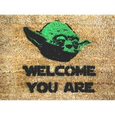 Anastrophe (the inversion of natural grammatical order) is represented here - perhaps too obviously - with a Yoda doormat with his anastrophic greeting.