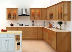If you love wood and want a warm and inviting environment, then a medium-toned wood kitchen is a natural choice! Medium wood kitchen cabinets are perfect L Shaped Kitchen Cabinets, Small Kitchen Cabinet Design, Simple Kitchen Cabinets, Kitchen Cupboard Designs, Simple Kitchen Design, Kitchen Countertops, Kitchen Backsplash, Kitchen Vanity, Backsplash Ideas