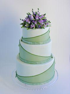 Green wedding cake with purple tulips