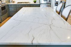 Aria Quartzite has a creamy white background that features deep black and grey veining. The neutrality of this stone can complement contemporary or traditional designs. White Quartzite Countertops, White Quartz Counter, Porcelain Countertops, How To Install Countertops, Laminate Countertops, Concrete Countertops, Home Decor Kitchen, New Kitchen, Kitchen Reno