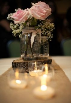 Pink or other pastel colored roses add a soft romantic appeal to rustic wedding decorations.