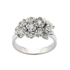 KAREN WALKER WILD FLOWER POSIE RING 9 ct White Gold KWD6. 11 x Round Brilliant Diamonds  G-H / SI2 0.42 tdw. Available in 9 ct Yellow Gold. Purchase in store or online. 98 Richmond Rd, Grey Lynn. www.dor.co.nz Free shipping. #Freeshipping #karenwalker #kw #karenwalkerjewellery #jewlry #jewellery #diamond #diamonds #yellowgold #whitegold #flower #flowers
