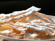 Fried pastries of this type can be found across Italy, particularly during the carnival season. Cenci mean tatters, which is what these pastries look like before you fry them. They are great warm or at room temperature, but should be eaten the same day. In Umbria, a sweetened, bright pink Alkermes liqueur is drizzled across the pastry before serving them.