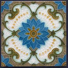 Antique art nouveau Tube Lined Majolica Ceramic Tile. Central light-blue flower with olive stems off it, and white fill.