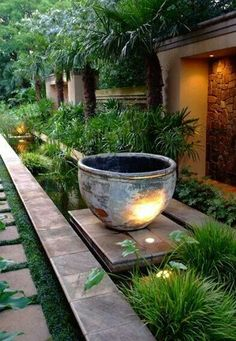 Gardens Gardening Landscaping with Pavers, Stone Path, Large Urn, Grasses, Palms