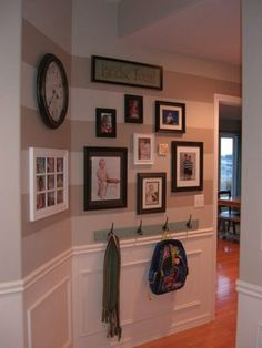 I have used this idea of hooks as a chair rail replacement in order to create a picture wall (like the one shown here)