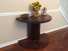 Large wooden spool cut in half sanded, stained and polyurethaned.