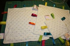baby tag blankets. assorted ribbons and minky fabric.