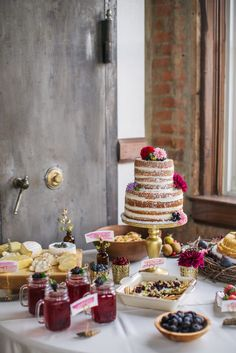 A buffet table of goodies including the wedding cake Photography by Rachel Whyte #nakedcakes #reception #buffettable