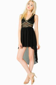 A stylish combination of tough and sweet, this sleeveless hi lo dress features a cutout bodice with mesh insets and studded detail. V-neck. Concealed zip closure in the back. Chiffon skirt. Partially lined.