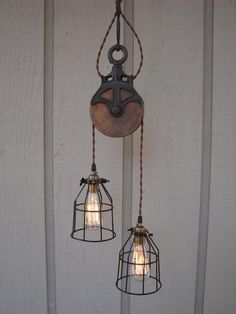 Light made out of an old pully. Very cool. @Carol Deardorff?