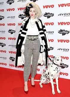 CRUELLA DE DISCO?? DRESSED AS DISNEY VILLAIN CRUELLA DE VIL, AUSTRALIAN RAPPER IGGY AZALEA ROCKED OUT AT THE VEVO HALLOWEEN SHOWCASE IN LONDON ON 10/31/13