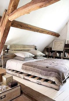 A bed frame made from pallets.