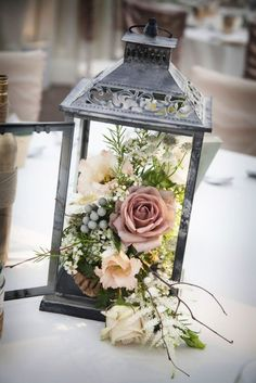 A rustic lantern–in place of a vase–adds a rustic touch to an outdoor party or wedding.  #homestyle #home #spring #homedecor #diy