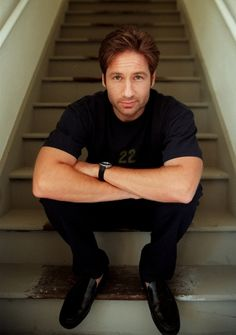 Rather than spend a lot of money re-carpeting old stairs, dress them up with a little David Duchovny in black.