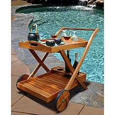 Entertain with simply lovely furniture that harmonizes with the beauty of natureGorgeous wood outdoor serving cart provides an easy way to roll the party into the fresh airPatio furniture is constructed of eucalyptus hardwood
