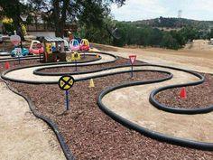 Outdoor bike/cozy coupe track. Top idea for preschool backyard.