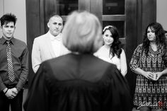 Great moment captured from a different perspective! The bride and groom with their witnesses in black and white