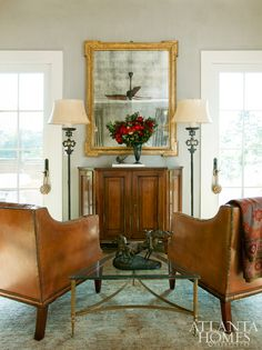 Master Suite | Kristen Marooney Walls and Shane Robuck | A pair of French leather chairs flanking a scantonata credenza