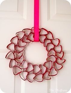 Valentines Kids Crafts with red strips of red construction paper made into heart and glued together