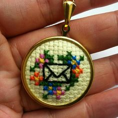 Items similar to Cross Stitch Envelope and Flowers Necklace in Spring Pastels and Gold on Etsy Embroidery Hoop Crafts, Learn Embroidery, Cross Stitch Embroidery, Cross Stitch Patterns, Tiny Cross Stitch, Cross Stitch Boards, Cross Stitching, Gold Cross, Etsy
