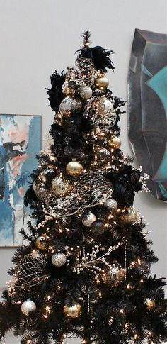 a black Christmas tree decorated in gold and silver for a chic gothic inspired l. a black Christmas tree decorated in gold and silver for a chic gothic inspired l. Black Christmas Tree Decorations, Elegant Christmas Trees, Silver Christmas Tree, Colorful Christmas Tree, Noel Christmas, Beautiful Christmas, White Christmas, Christmas 2019, Colors