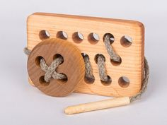 Wooden toy lacing table with button by thewoodenhorse on Etsy, $16.00