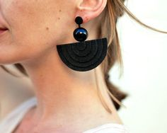 Mod earrings, Minimal earrings, Geometric earrings, Statement earrings, Lightweight earrings, 60s earrings, Big black bold earrings, Felt earrings  Inspired by 60s mod fashion! These black geometric statement earrings are made of vintage plastic beads, hand dyed felt fabric and hypoallergenic stainless steel studs. The material looks a bit like suede leather. The earrings are so lightweight and comfortable, that you will forget you are wearing them. Earrings dimension : 6,5 x 6 cm (approx…