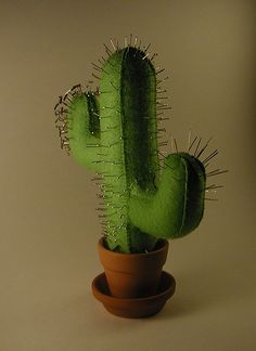 Cactus pincushion! @Katie Hrubec Hrubec Anna we HAVE to try to find or make one of these for you!!!!