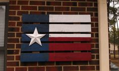An old pallet and some paint. God bless Texas. (on the porch someday!)