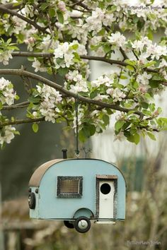 birdhouse shaped and painted to look like a camper! so neat!