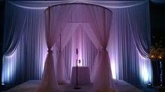 Beautiful wedding canopy / chuppah with valanced backdrop and LED uplighting