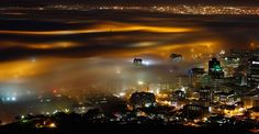 Seasonal fog is illuminated by the lights of Cape Town harbour as the city prepares for the start of the southern hemisphere winter. Cape Town is only an hour away from Franschhoek home of La Clé des Montagnes- 4 luxurious villas on a working wine farm Sick, Cities, Start Of Winter, Cape Town South Africa, Pretoria, Pictures Of The Week, Time Pictures, Urban Photography, Cape Town