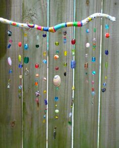 A painted stick and a collection of beads and bits. Super simple and looks great :)