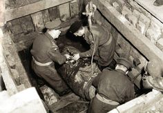 Royal Engineers defusing a pound high explosive bomb found in Dagenham, Essex - UK 21 May 1949