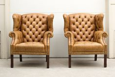 Rare Vintage Tufted Leather Wingback Library Chairs with Ottoman. $2,995.00, via Etsy.
