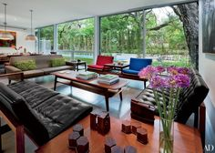 The living room's sliding glass doors lead out to the pool area and allow for breezy indoor-outdoor living.