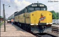 """Chicago & North Western """"Crandall Cab"""" #502 boards passengers at a Chicago commuter stop during May of 1982.  These unique, but ugly, locomotives were rebuilt by the railroad from cabless """"B"""" units for use in commuter service."""
