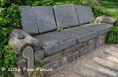 Chanticleer rocks a Gravel Garden | Digging stone sofa with a remote.