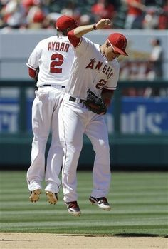 Game #86 7/8/12: Los Angeles Angels shortstop Erick Aybar, left, and center fielder Mike Trout celebrates their 6-0 win against the Baltimore Orioles in a baseball game in Anaheim, Calif., Sunday, July 8, 2012. (AP Photo/Chris Carlson)