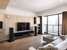 Apartments:Inspiring Apartment Design With Custom Wood Paneling Along With Flat Television Cabinets Plus Clock And Curtains With Glass Windows And Sliding Glass Door Connected Balcony With White Sofa And Laminate Wood Flooring Modern Apartment Design with Creative Wood Decorations