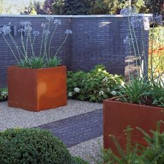 Adezz Corten Steel garden troughs, squares, cubed planters, tall square planters and low square planters. Over 29 styles of extra large weathering steel commercial garden planters to choose from.