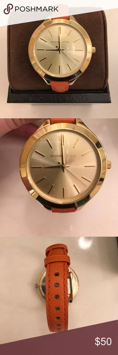Michael Kors watch Gold watch face, orange leather wristband, authentic Michael Kors Accessories Watches