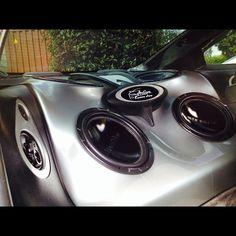TR55 series subwoofers in a custom fiberglass enclosure replacing the rear seat.