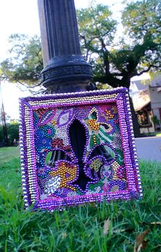 Recycling Mardi Gras beads into mosaics - what a great idea!  Artist nolabeadart   #repurpose #reuse #recycle