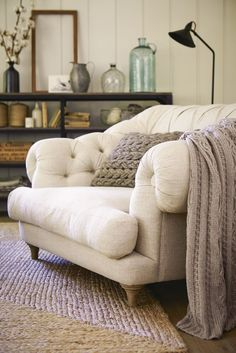 Loaf's Chesterfield style Bagsie love seat snuggler chair in a neutral cotton