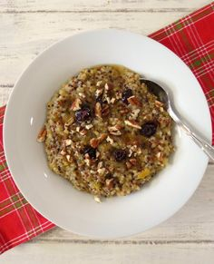 Winter Harvest Quinoa Oatmeal - A thick, hearty, gluten free, healthy breakfast made with quinoa, pureed butternut squash and topped with cranberries and pecans.