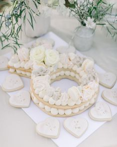 Wedding Cookies That Will Sweeten Up Your Dessert Table Wedding dessert tables have come a long way. What used to be a station reserved for a traditional cake has now grown into displays full of sweets and treats that guests can choose from. Elegant Dessert Table, Dessert Bar Wedding, Elegant Desserts, Wedding Cookies, Wedding Desserts, White Dessert Tables, Dessert Buffet, Table Wedding, Elegant Cakes