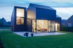 Fibre cement slate cladding can provide a smooth, continuous building envelope, as on this house in Belgium where Marley Eternit's Vertigo range was specified Architecture Extension, Modern Architecture House, Contemporary Buildings, Modern Houses, Tiny Houses, Building Design, Building A House, Building Ideas, Fibre Cement Cladding